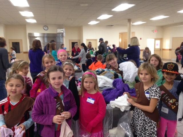 Children receiving KidPacks from Cradles to Crayons.
